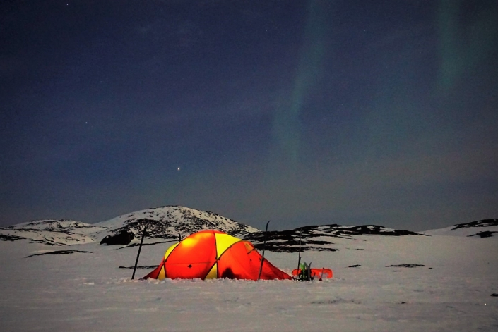 Tent with Northern Lights. Photo by Nuuk Adventure - Visit Greenland