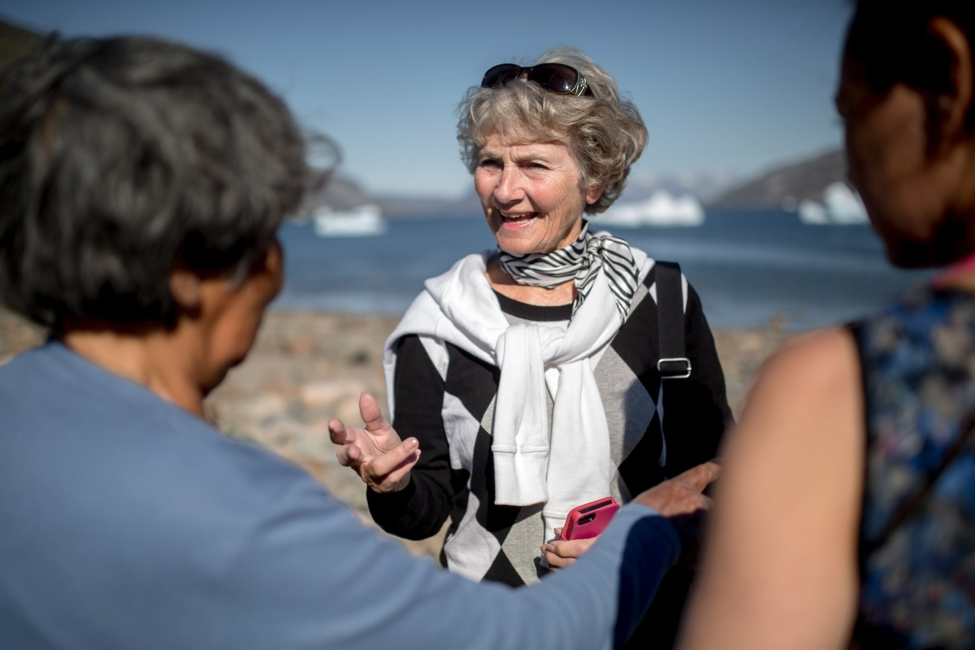 A guest talking to a local woman in Narsaq in South Greenland. Photo by Mads Pihl - Visit Greenland