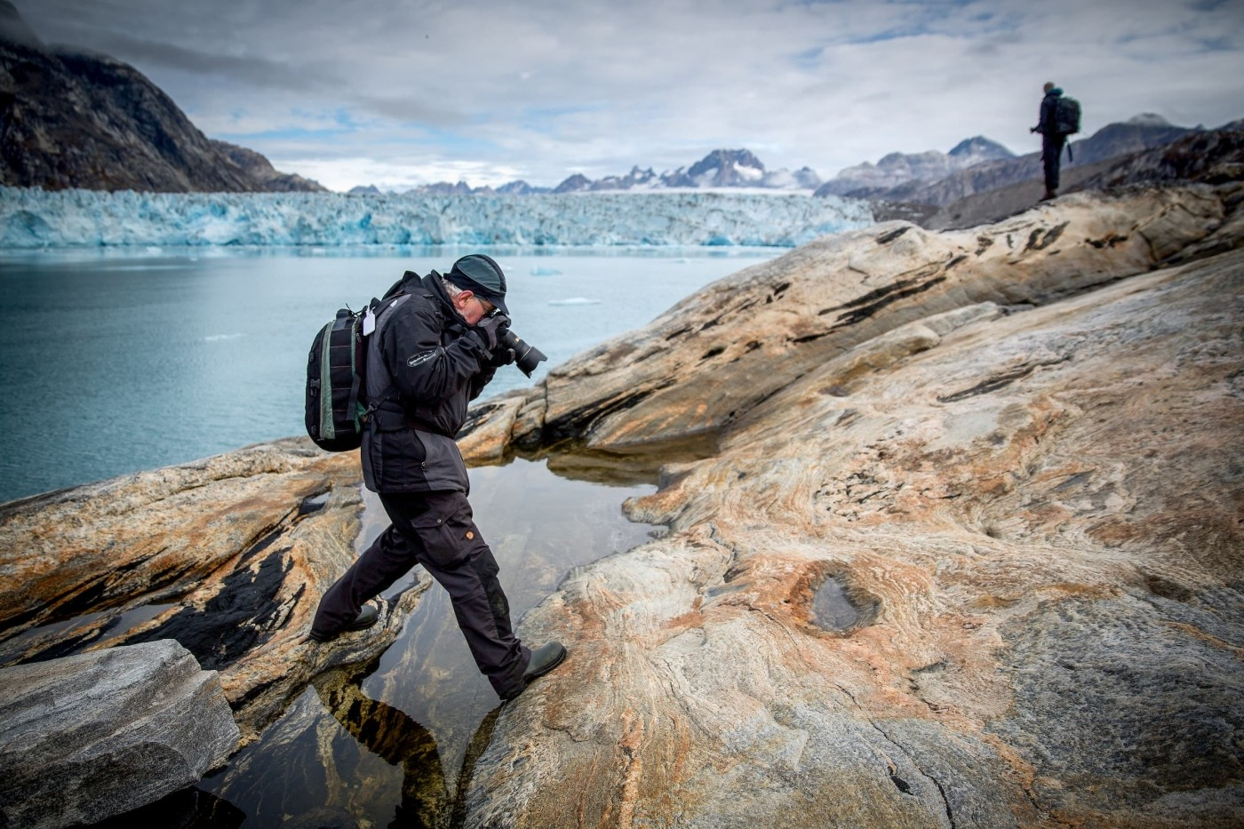 A photographer focusing on rock lines and details near the Knud Rasmussen glacier in East Greenland. By Mads Pihl