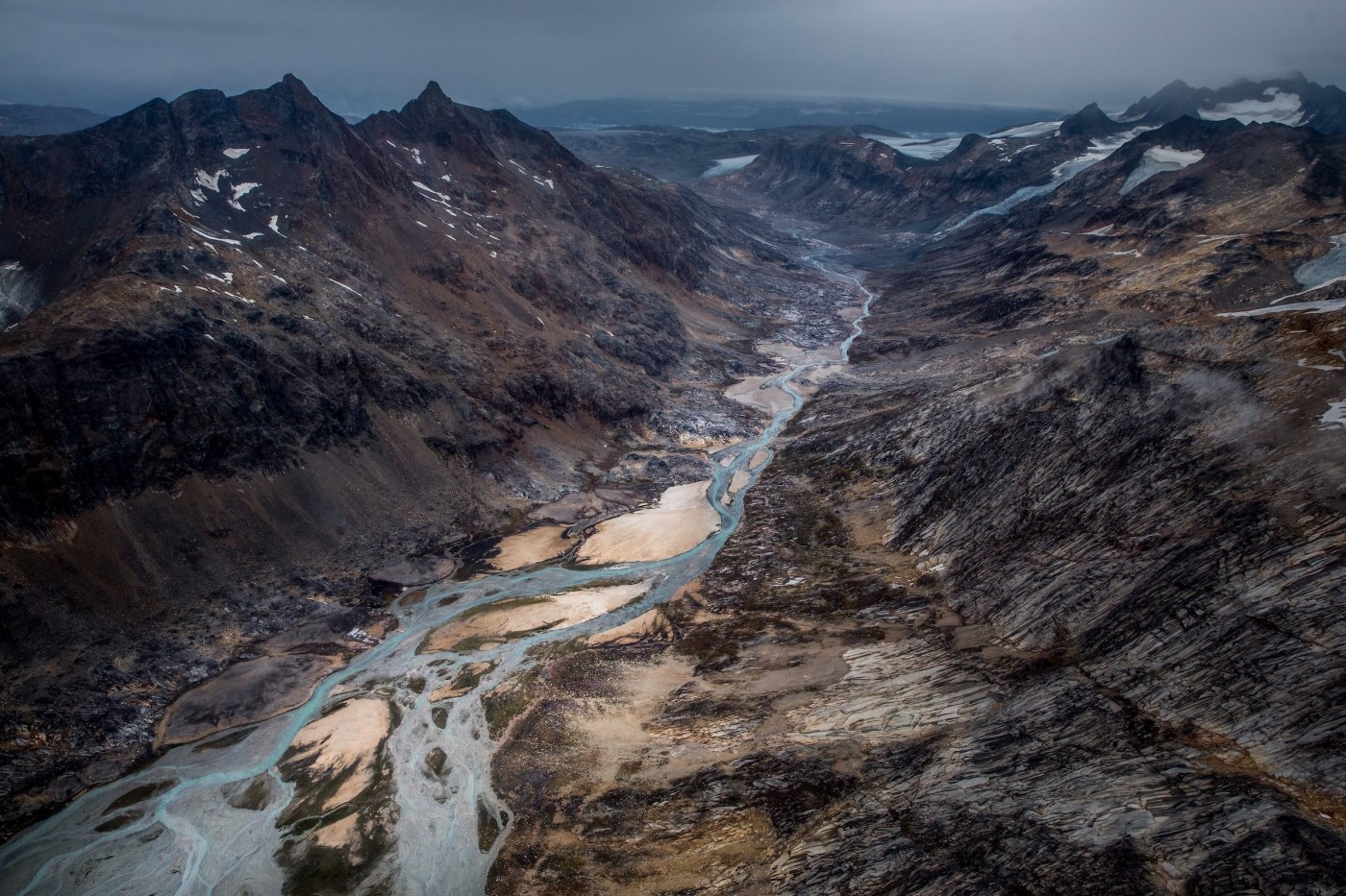A river valley draining a glacier near Tasiilaq in East Greenland. Photo by Mads Pihl - Visit Greenland