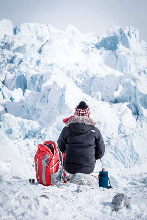 A single snowshoe hiker living in the moment looking at any ice landscape ahead. Photo by Samuel Letecheur - Visit Greenland