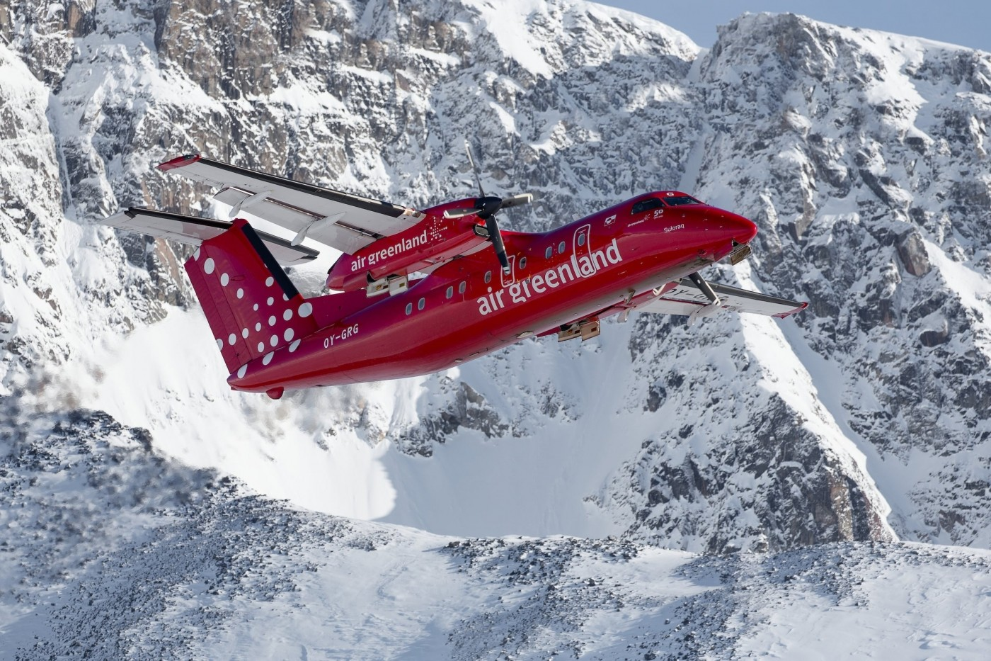 An Air Greenland Dash-8 taking off from Kulusuk in East Greenland. Photo by Mads Pihl - Visit Greenland