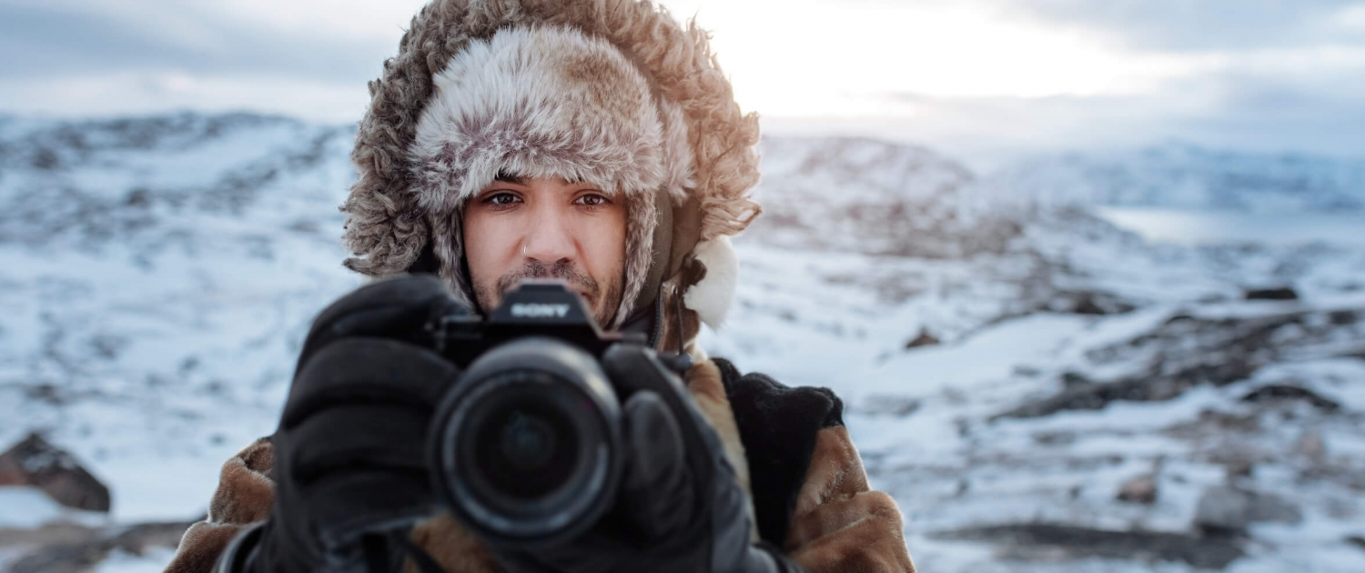 Canadian social media influencer Siya Zarrabi taking photos in seal skin clothes near Ilulissat in Greenland