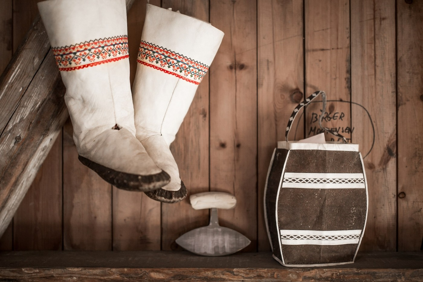 Kamiks and souvenirs at the Hotel Narsaq shop on the old harbour in Narsaq in South Greenland. Photo by Mads Pihl - Visit Greenland
