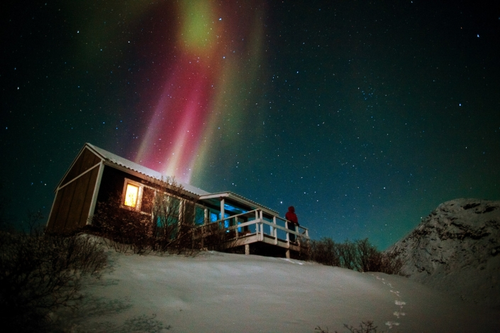 Northern Lights over a hut in the Kangerlussuaq backgrountry in Greenland. Photo by David Trood - Visit Greenland