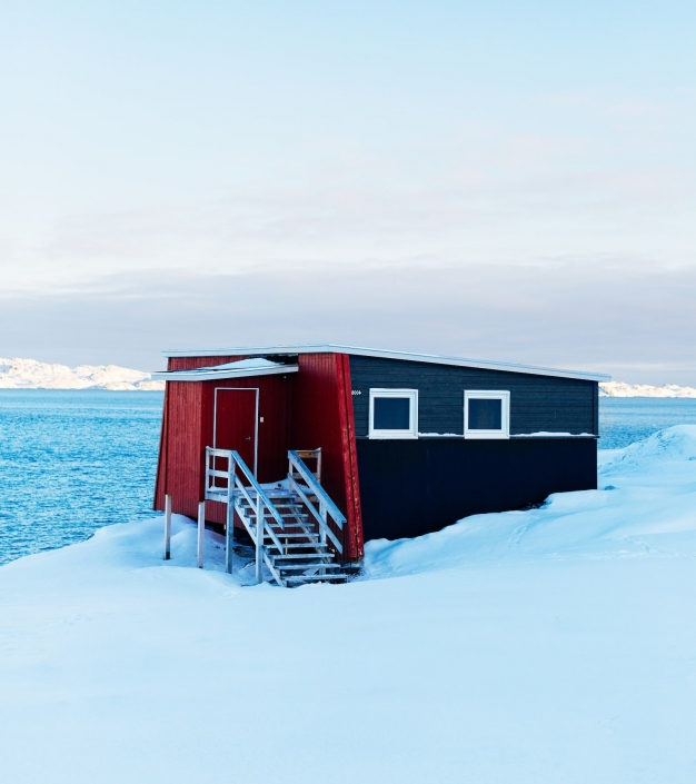One of Inuk Hostels cabins on a winter day in Nuuk in Greenland. Photo by Rebecca Gustafsson - Visit Greenland