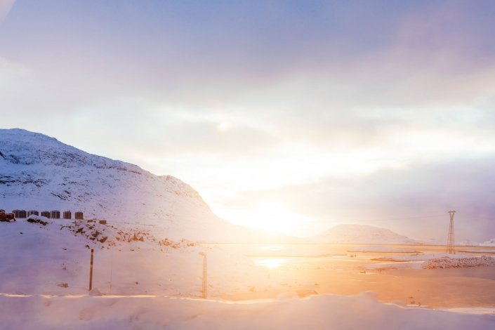 Sun rising on a winter morning in Nuuk in Greenland. Photo by Rebecca Gustafsson - Visit Greenland