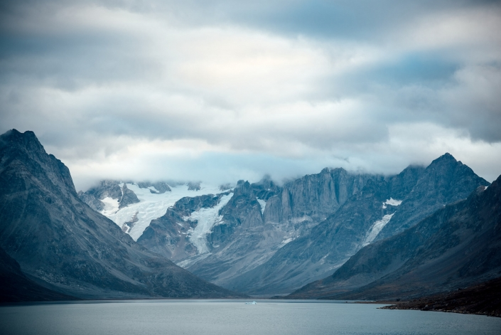 Three peaks in the foggy distance, looking North, Entrance Of Tasiilaq Fjord. Photo by Chris Brin Lee Jr. - Visit Greenland