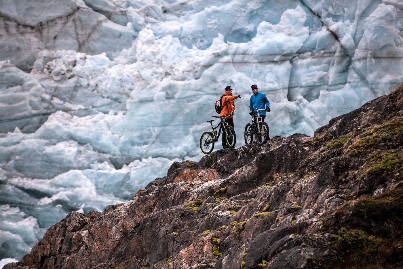 Two mountainbikers looking for a trail near Russell Glacier in Greenland. Photo by Mads Pihl - Visit Greenland