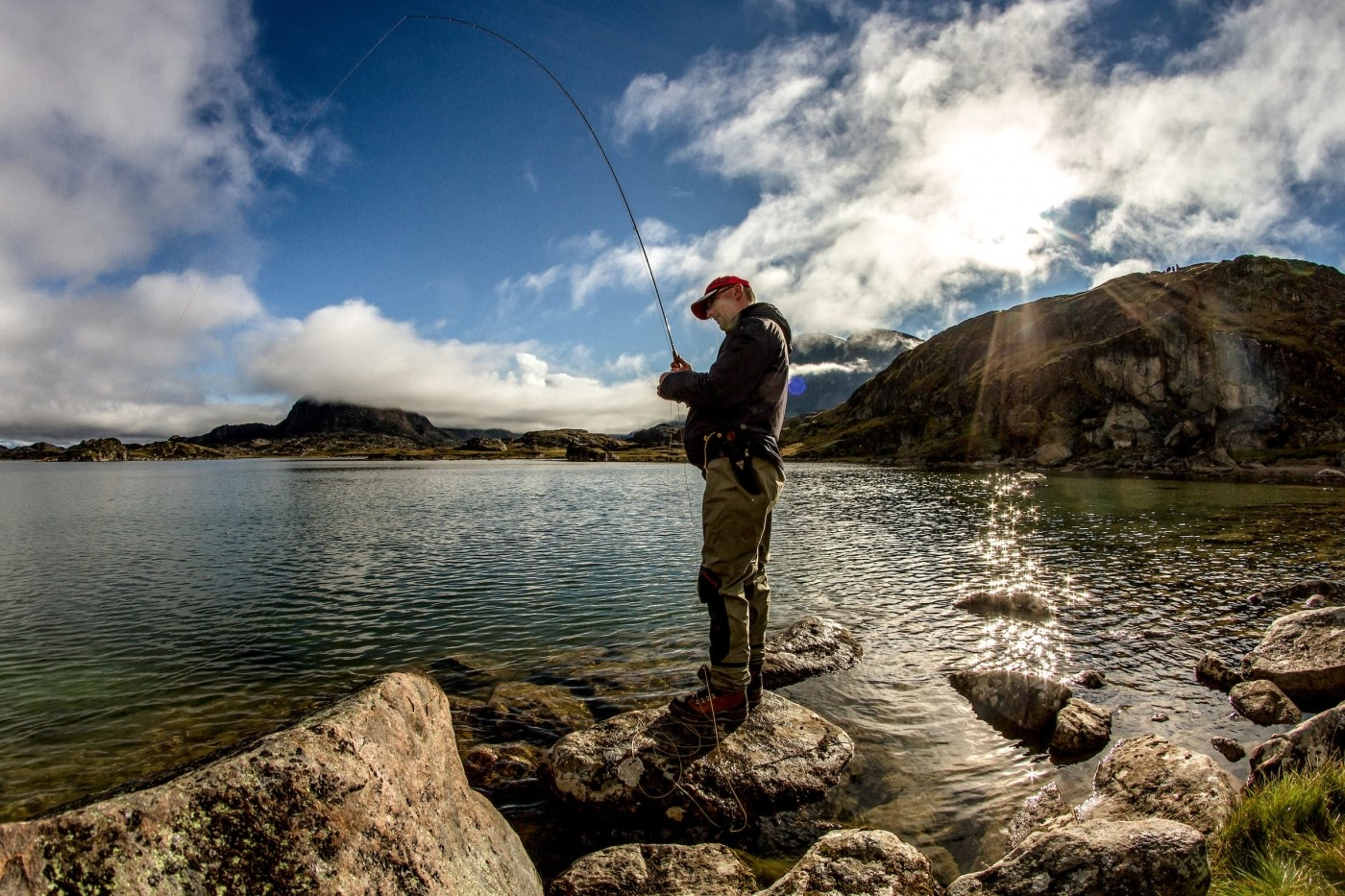 A fisherman at the shores of a lake near the river Erfalik in Greenland. Photo by Mads Pihl - Visit Greenland