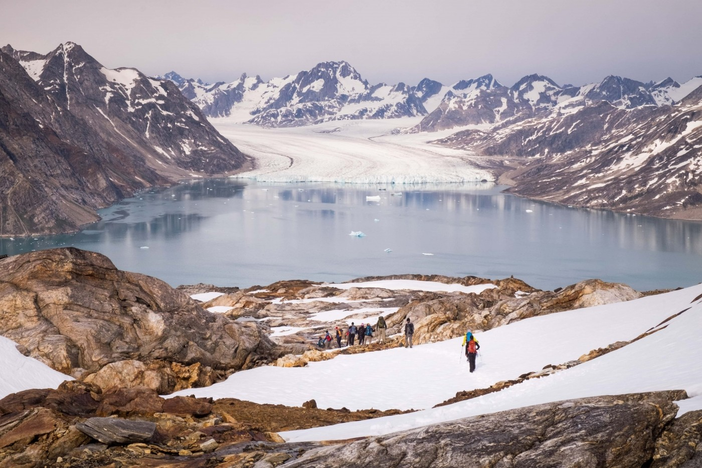 East Tasiilaq summer knud-rasmussen glacier from mountain view with hikers. Photo by Guide to Greenland