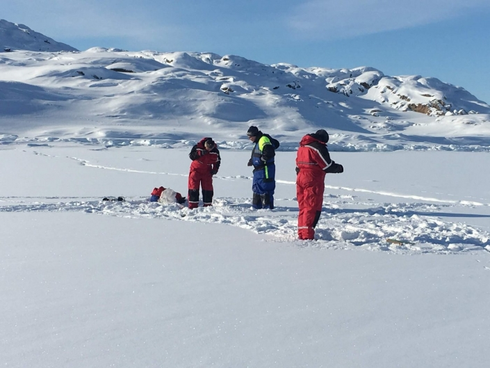 Local guide and tourists ice fishing. Photo by Ilulissat Water Safari - Visit Greenland