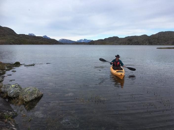 Man with cowboy hat kayaking. Photo by Greenland Waterways - Visit Greenland