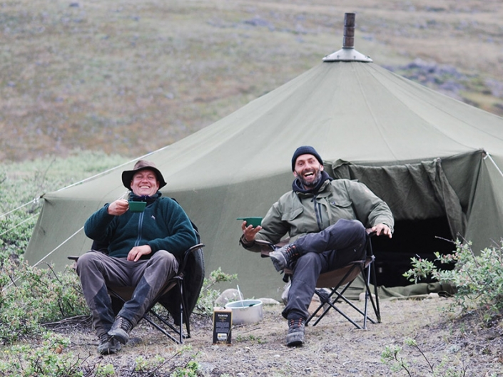 North Safari Travel guides relaxing with a cup of wine at camp. Photo by North Safari Travel - Visit Greenland