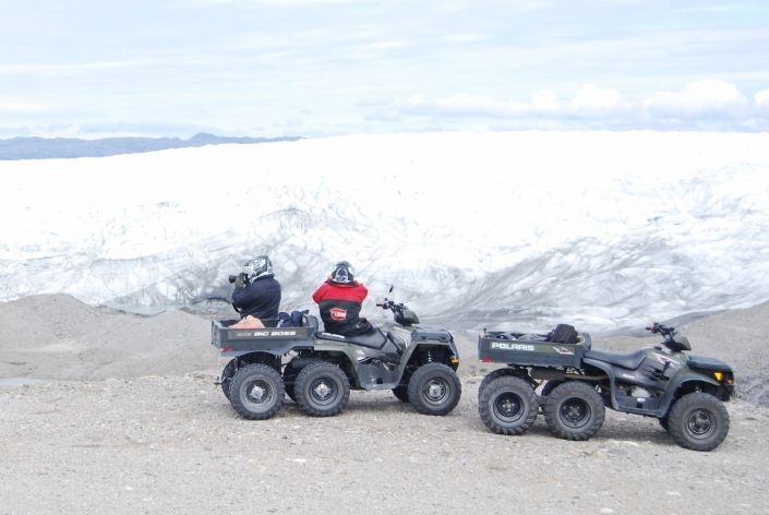 North Safari Travel tour tourists on ATV photographing glacier. Photo by North Safari Travel - Visit Greenland