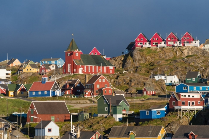 Sisimiut town and its colourful buildings in sun. Photo by West Greenland Wildlife - Visit Greenland