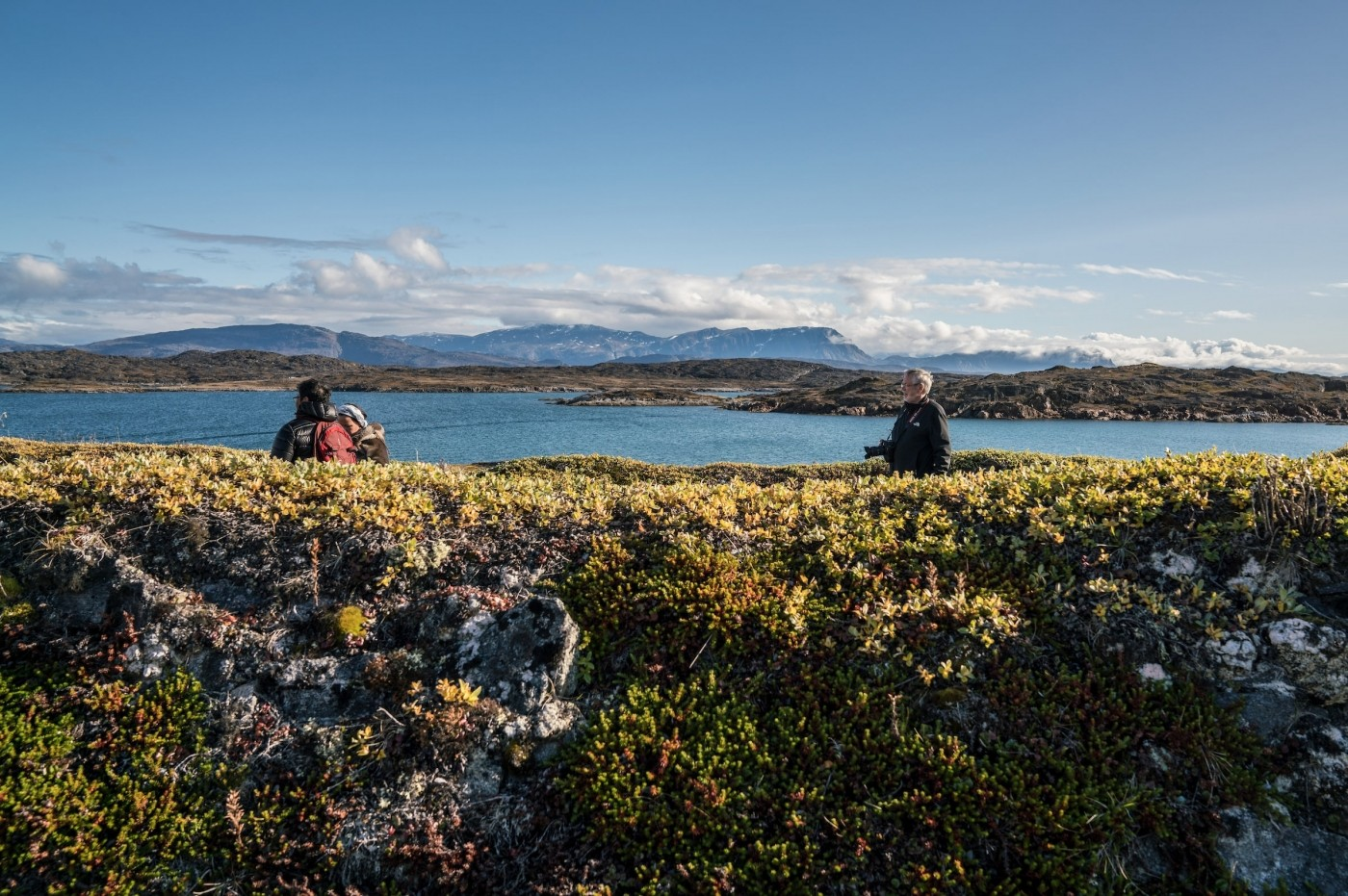 Tourists and local guide exploring Nipisat Island. Photo by Per Arnesen - Visit Greenland