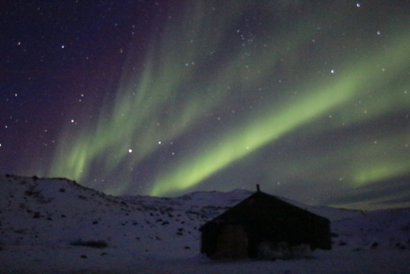 Winter camp and Northern Lights in Kangerlussuaq. Photo by North Safari Travel