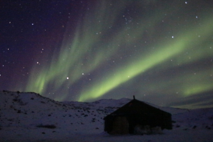 Winter camp and Northern Lights in Kangerlussuaq. Photo by North Safari Travel - Visit Greenland