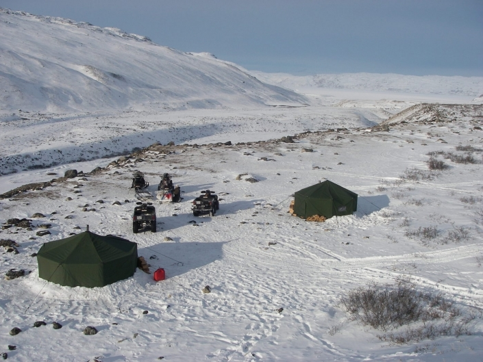 Winter camp in Kangerlussuaq with tents ATV and snowmobiles. Photo by North Safari Travel - Visit Greenland