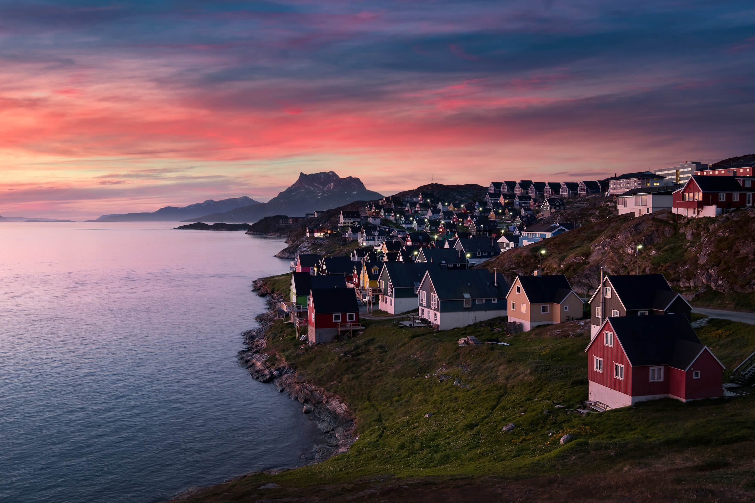 Pink sky, colourful Nuuk. Photo by Elia Locardi - Visit Greenland