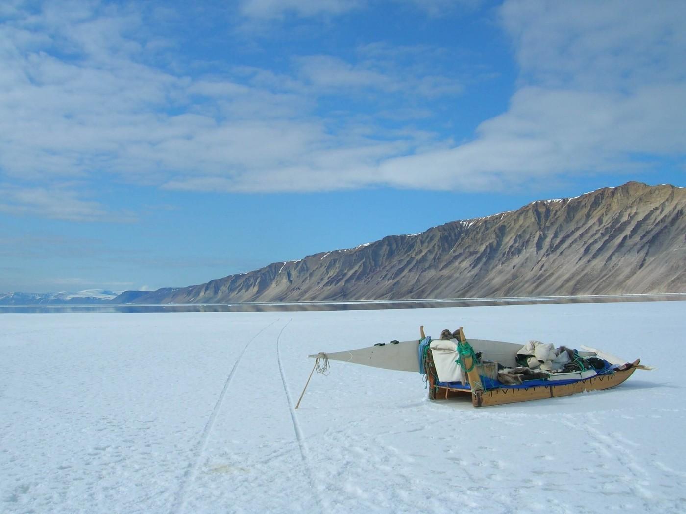 Loaded dog sled at the coast. Visit Greenland
