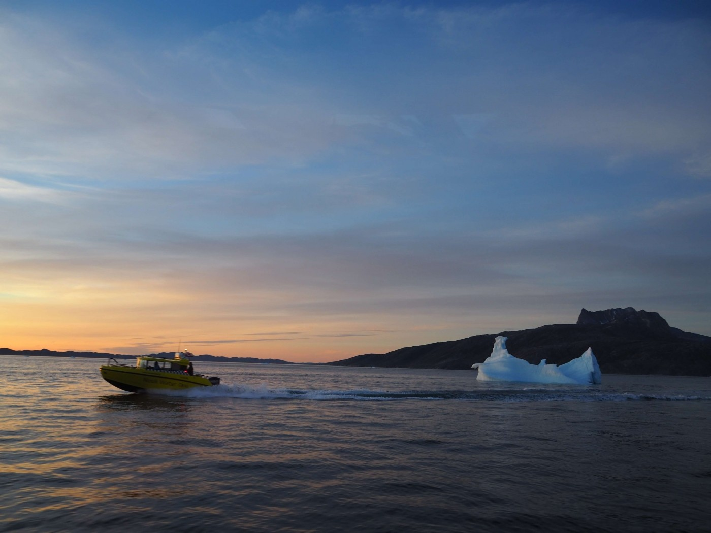 Speed boat during sunset. Visit Greenland