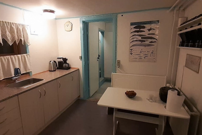 Fully quipped kitchen with dining area. Photo by Mikami Hostel