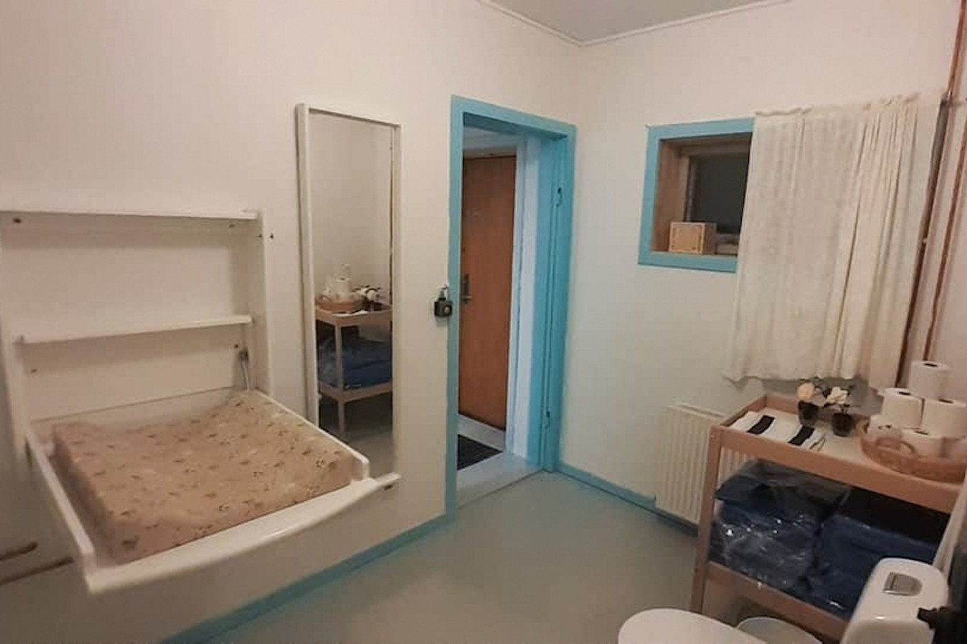 Bathroom with changing table. Photo by Mikami Hostel