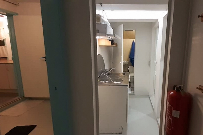 Toilet and laundry room. Photo by Mikami Hostel