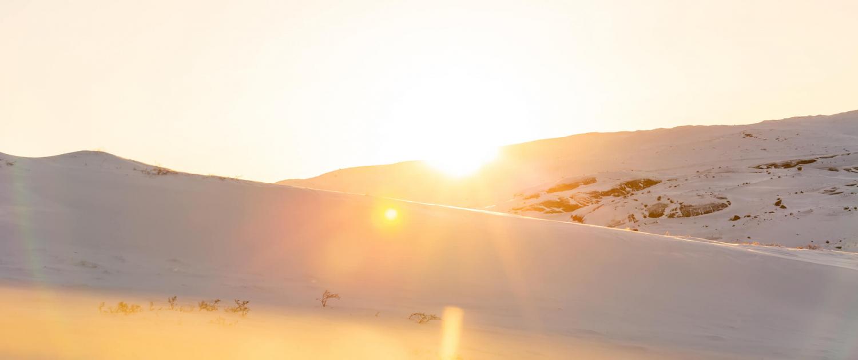sun just above mountain Kangerlussuaq. Photo - Filip Gielda, Visit Greenland