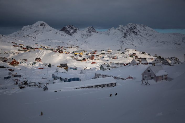 Morning light over Tasiilaq in East Greenland covered in deep snow