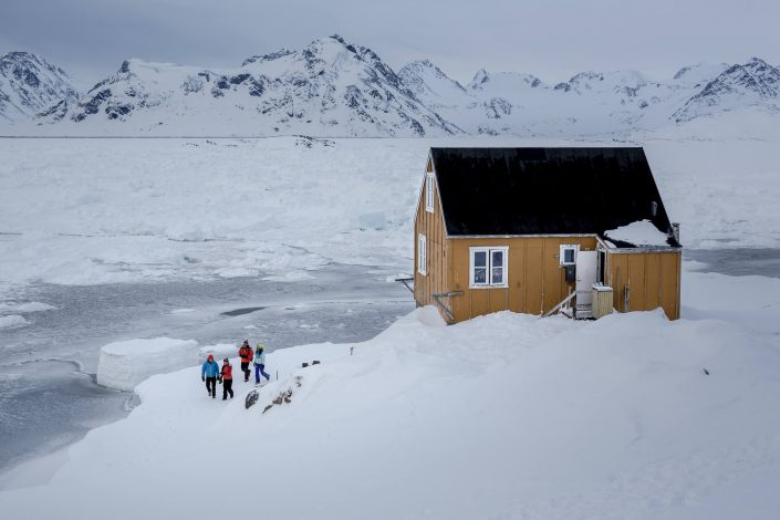A group of travelers on a walk in Kulusuk in East Greenland. By Mads Pihl