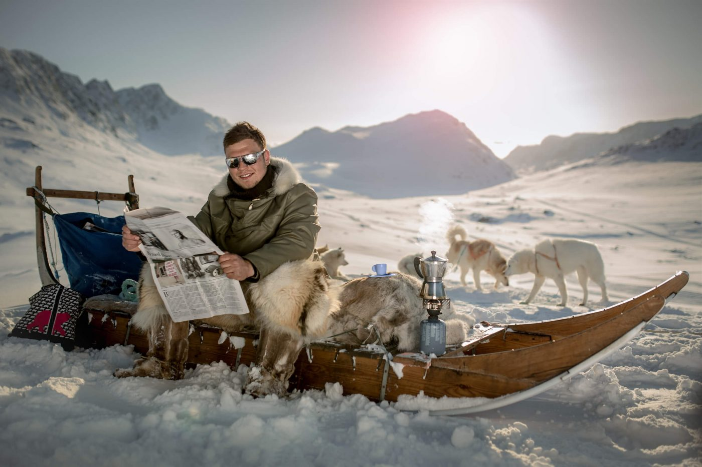 A dog sled driver from Sisimiut brewing espresso