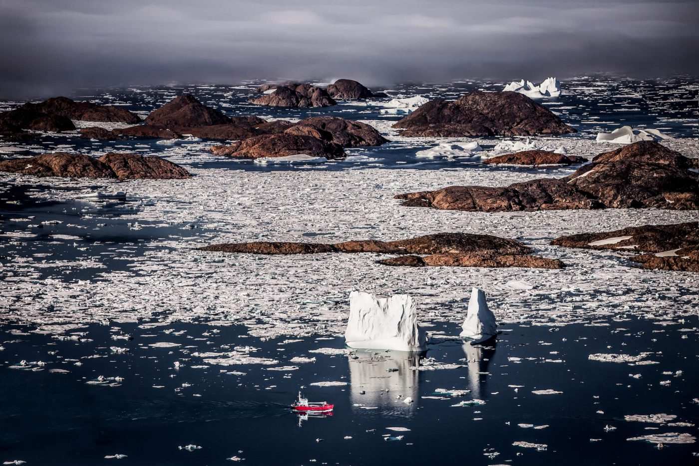 A Royal Arctic Line supply ship in the archipelago near Kulusuk in East Greenland. Photo by Mads Pihl