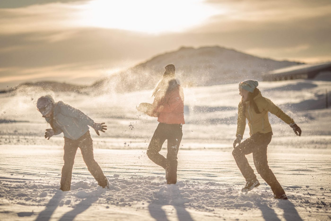 A sunset snowball fight in Kulusuk in East Greenland. Photo by Mads Pihl