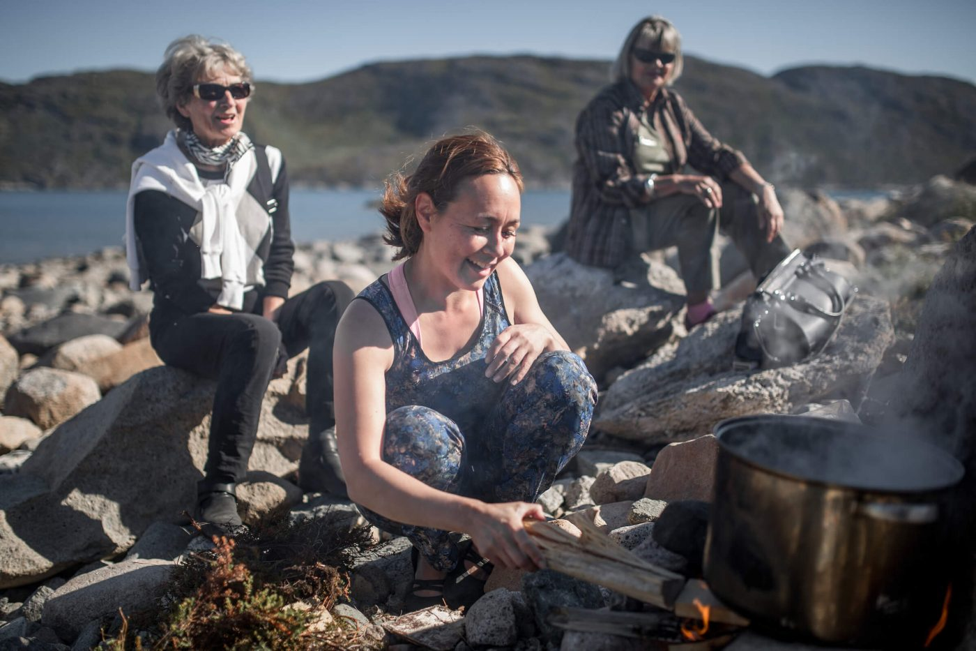 Cooking greenlandic food on open fire in Narsaq in South Greenland