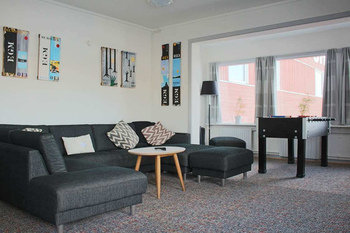 Living room with a large couch.Photo by Aasiaat Sømandshjem