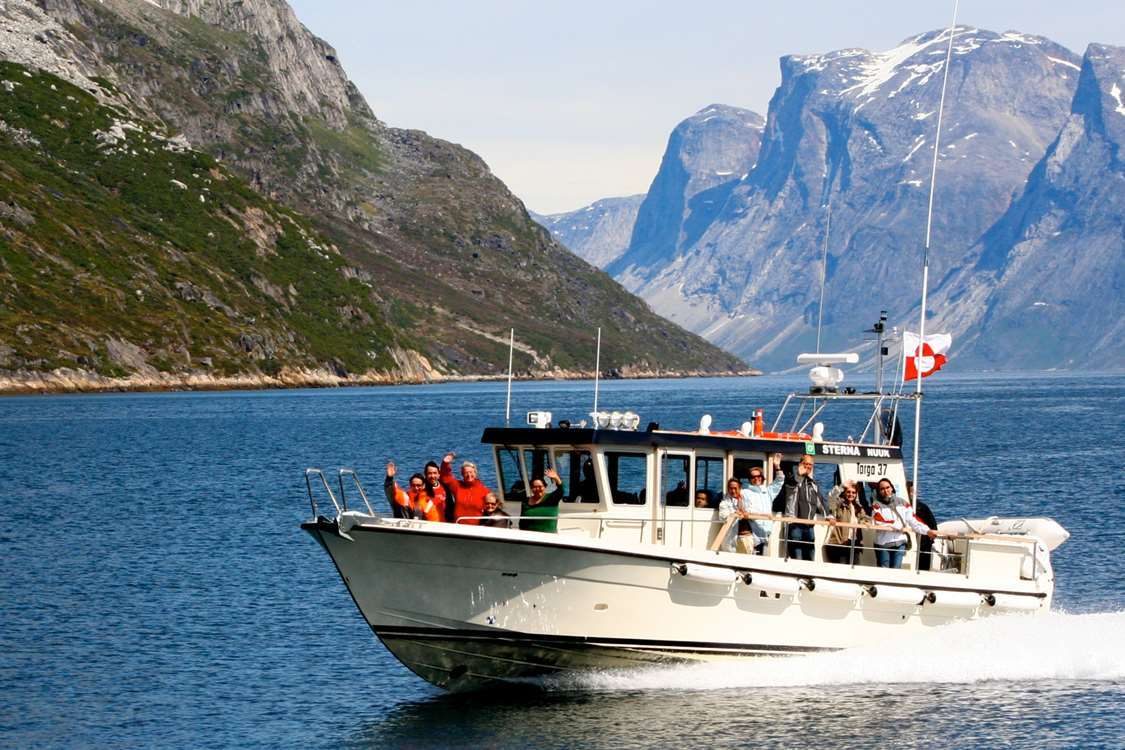 ABC Boat Charter guests on a trip in the Nuuk fjord. Visit Greenland