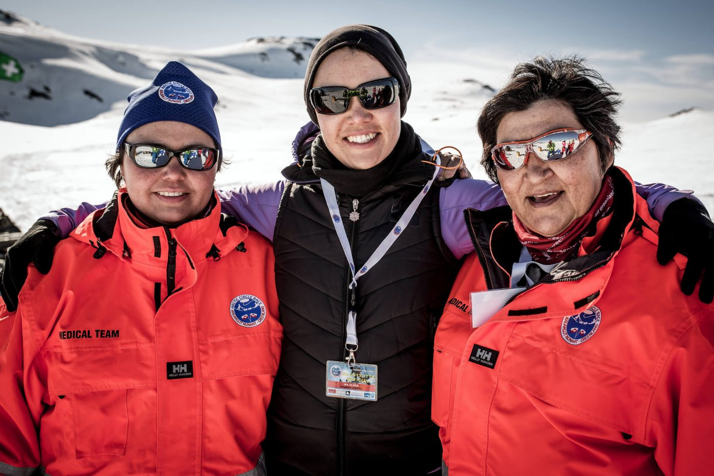 Volunteers at the Arctic Circle Race in Sisimiut. Photo by Mads Pihl, Visit Greenland