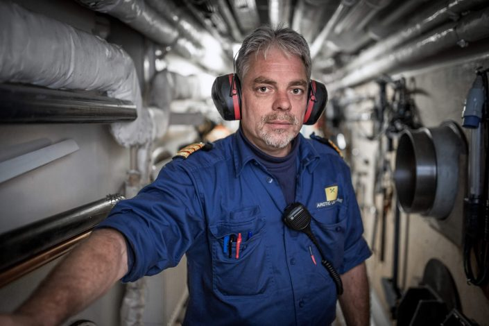 An officer from the Sarfaq Ittuk ferry in the engine room of the ship. Visit Greenland
