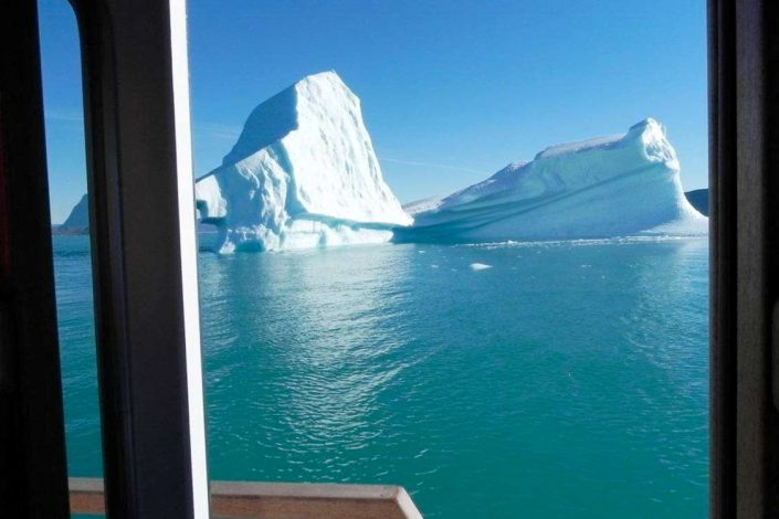 View of iceberg in Nuuk Fjord, Capital Region. Photo by Asimut Tours and Camp