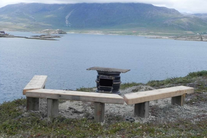 Grill area with benches of wood in Kapisillit. Photo by Asimut Tours and Camp