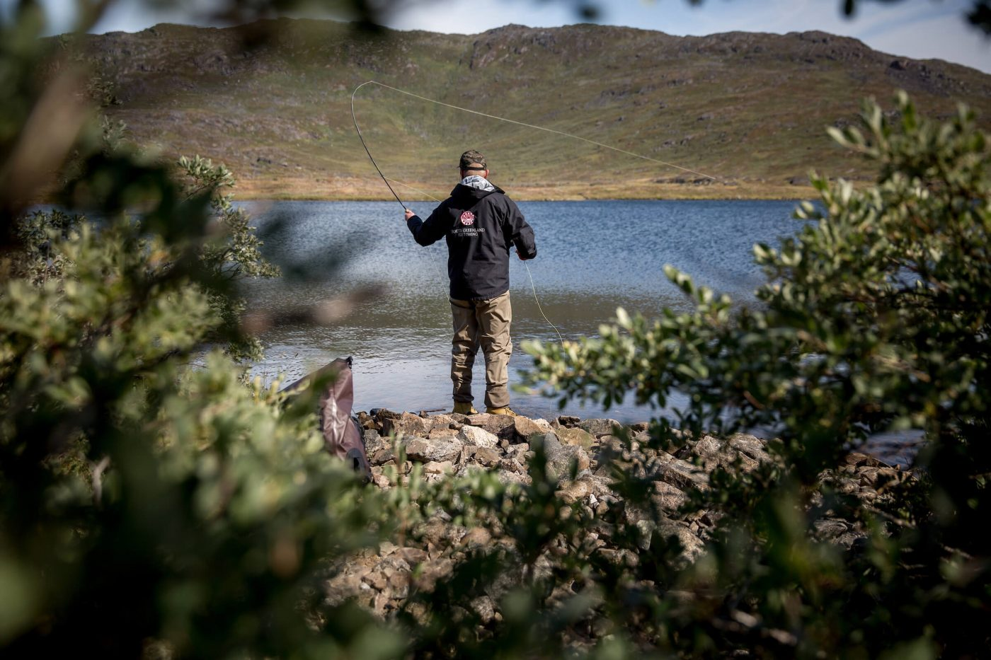 Fly fishing for arctic charr with the guide from South Greenland Fly Fishing. By Mads Pihl
