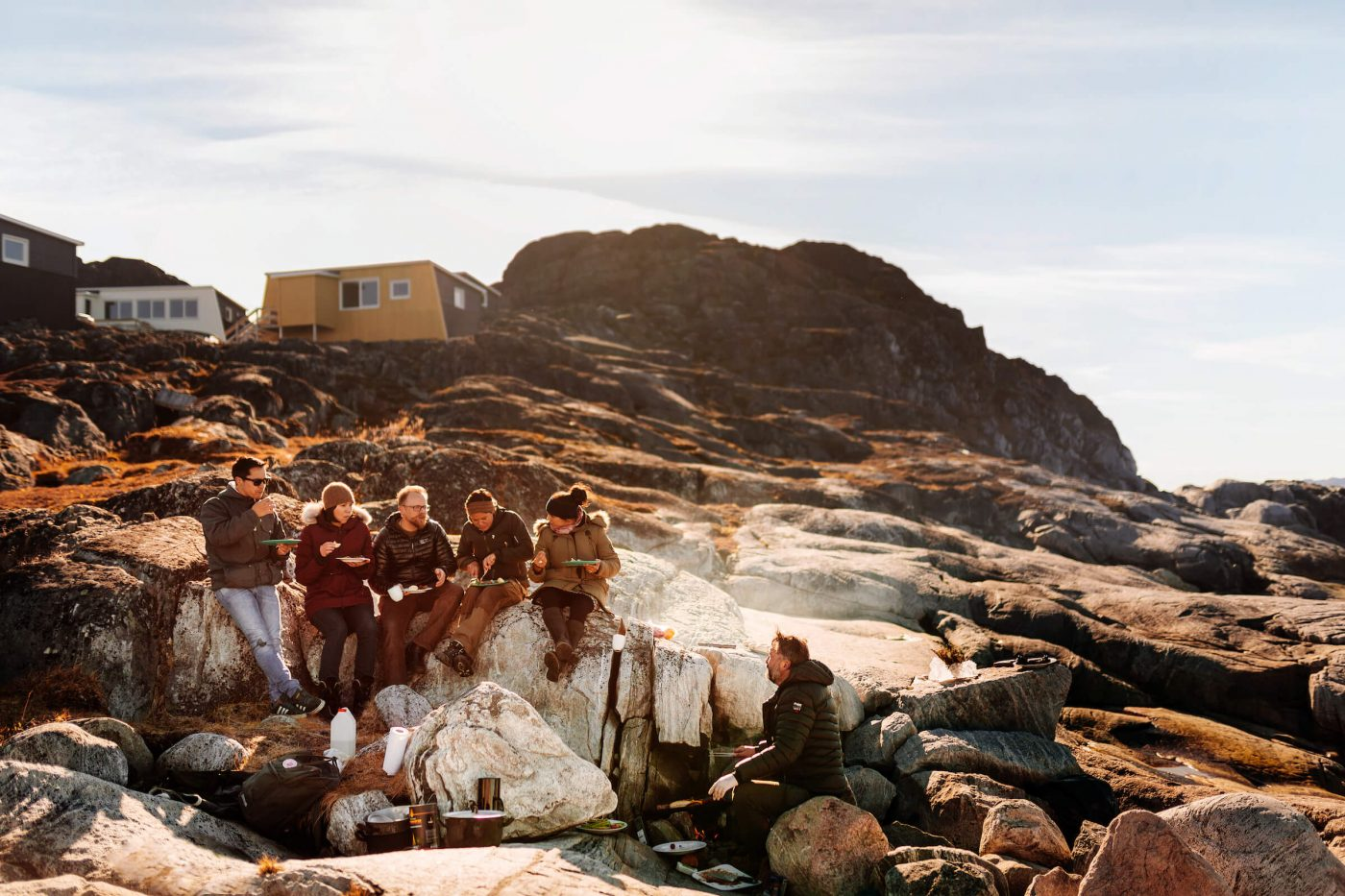 Group of friends barbequing on the beach of Inuk Hostels in Nuuk in Greenland. By Rebecca Gustafsson