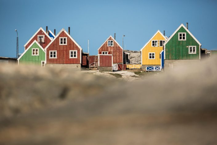 Colourful houses in Qasigiannguit in Greenland. Photo by Mads Pihl - Visit Greenland