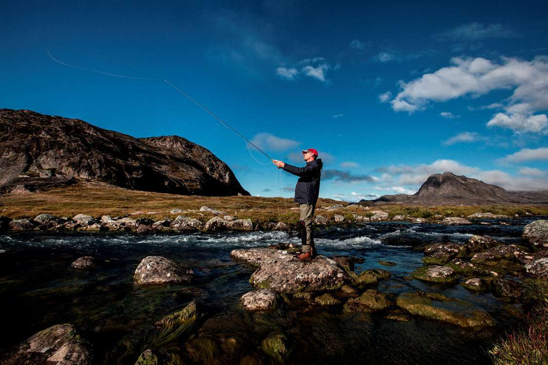 Fly fishing on the lower Erfalik river in Greenland. Photo by Mads Pihl, Visit Greenland