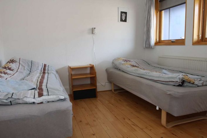 Large bedroom with two single beds, Photo by Iherit Accommodation, Visit Greenland