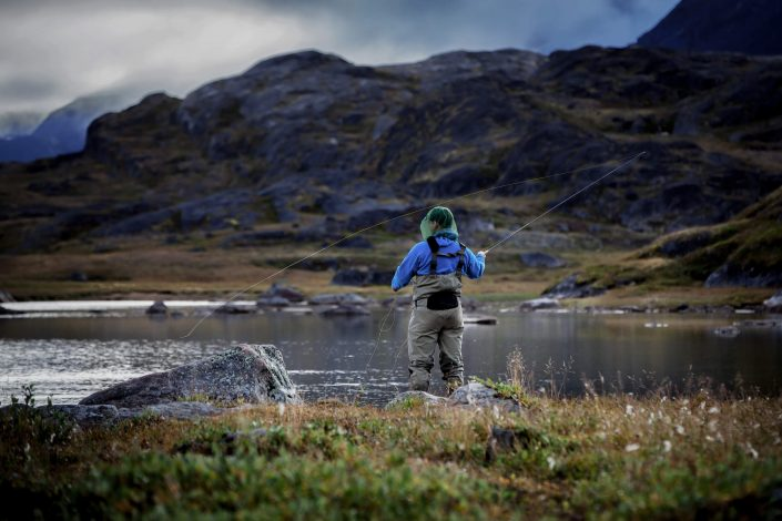 A fly fisherman enjoying the day on the river Erfalik in Greenland