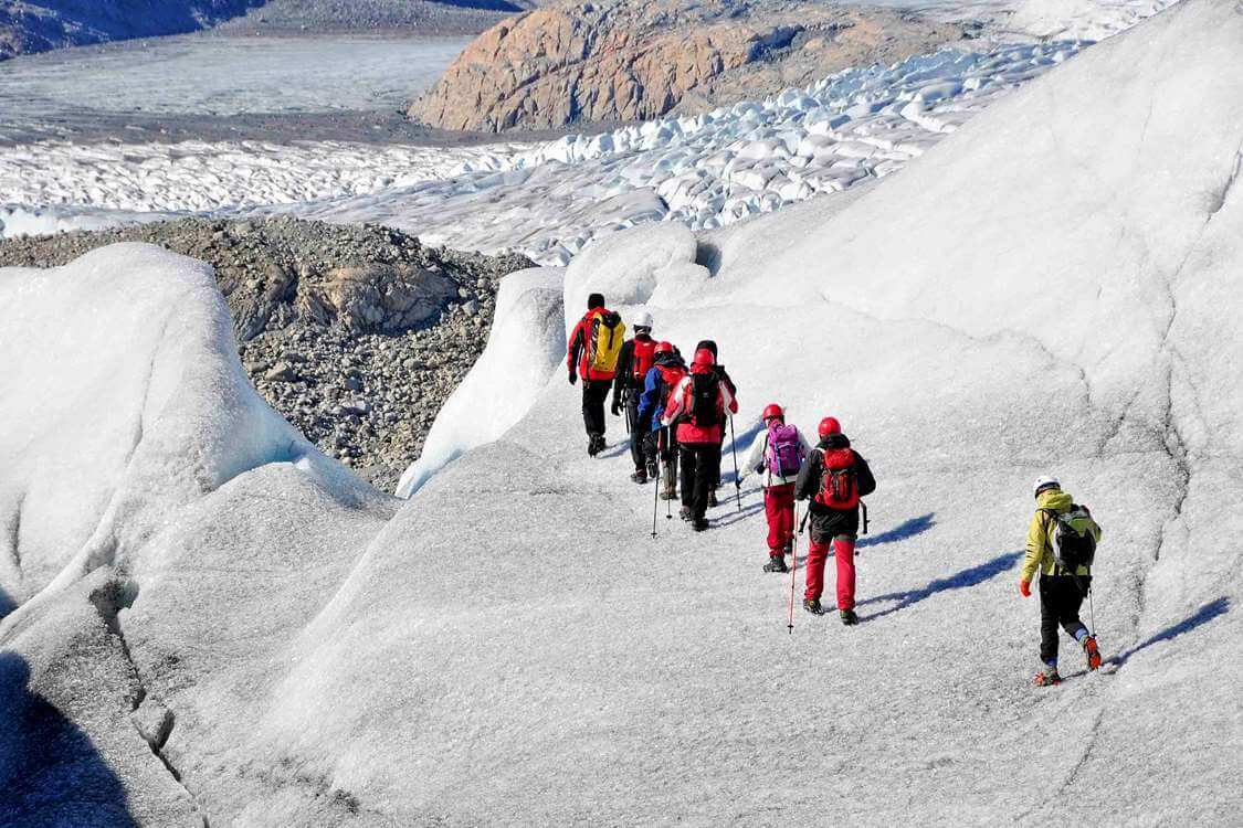 Hikers on a glacier in South Greenland with a view over the Inlandis. Photo by Tasermiut South Greenland Expeditions, Visit Greenland